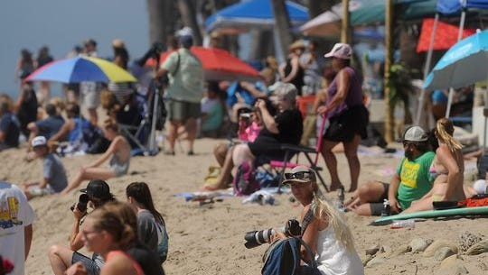 People crowd the beach to watch surfers during the 2014 Aloha Beach Festival and surfing competition at Surfers Point and Promenade Park in Ventura. Organizers canceled the event this year because of increased costs to put it on.