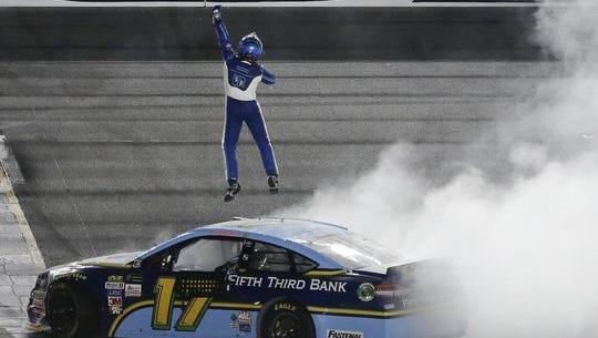 Ricky Stenhouse Jr. jumps above his car as he celebrates after winning the NASCAR Cup auto race at Daytona International Speedway, Saturday, July 1, 2017, in Daytona Beach.