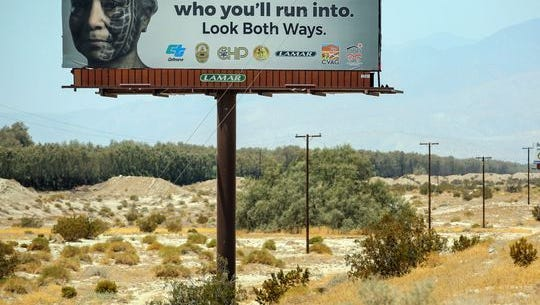 A billboard along Interstate 10 warns people of pedestrian safety. Local traffic officials installed it, but state officials also are encouraging people to be cautious through September, which is pedestrian safety month.