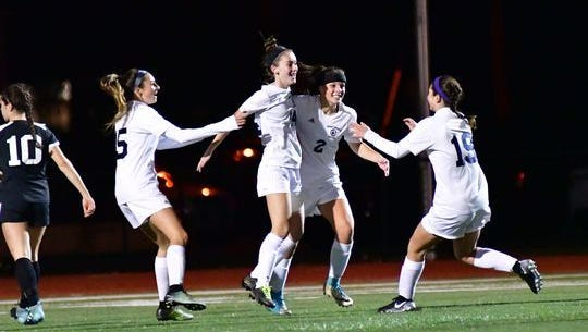 Middletown South players celebrate a first half goal, going on to upset Northern Highlands in the NJSIAA Group 3 semifinals Tuesday night.rt