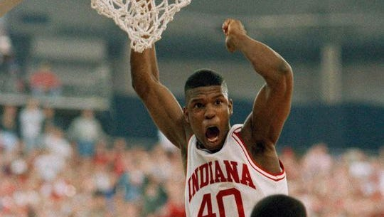 Indiana forward Calbert Cheaney dunks the ball against Wright State defender Mark Woods during their first-round NCAA tournament game in Indianapolis, March 19, 1993