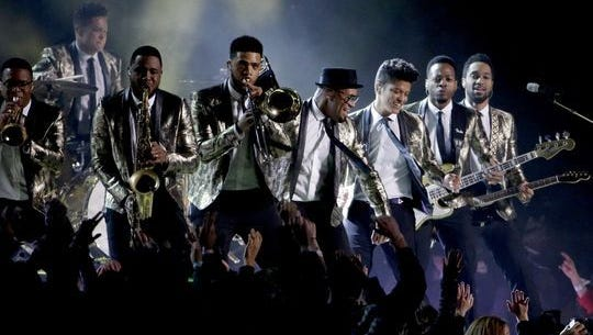 Trombonist Kameron Whalum performs with Bruno Mars at the 2014 Super Bowl.