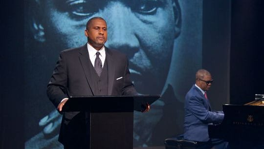 """Tavis Smiley, left, and Marcus Roberts pay tribute to a legend in """"Death of a King: A Live Theatrical Experience."""""""