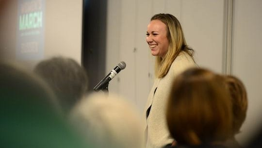 Meghan Wallace, of Mary Ann's List, speaks to the attendees of the Women's March Anniversary Celebration in Lewes in January.