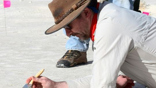 Matthew Bennett, professor of environmental and geographical sciences at Bournemouth University of England, is seen researching Ice Age trackways at White Sands National Monument.
