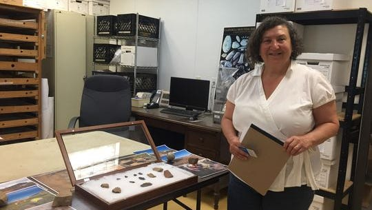 Ilene Grossman-Bailey shows arrowheads and pottery fragments discovered in South Camden in this 2016 photo.
