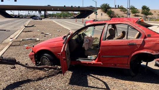 A red vehicle was severely damaged after it rolled with 5 teenagers inside in Gilbert on May 19, 2018. Three were critically hurt, officials said.