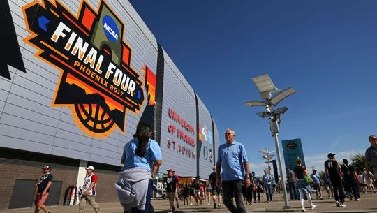 Fans walk outside University of Phoenix Stadium in Glendale prior to the 2017 NCAA basketball championship game between North Carolina and Gonzaga.