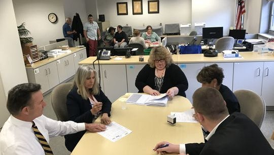 Morris County Board of Elections Administrator Dale Kramer counts provisional ballots with board of election commissioners on June 7, 2018 in Morristown.