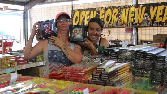 Roxanne Hamilton and Erica Phillips man Amy's Firework on Lea Street and Standpipe Road in Carlsbad, N.M. on July 3, 2017. The two women said annual sales of fireworks typically pick up on July 4.