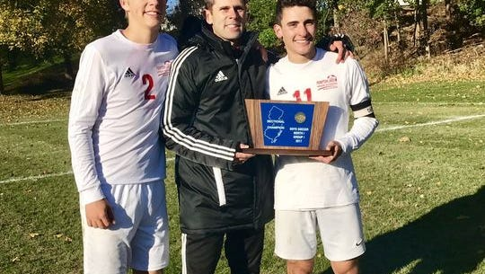 Pompton Lakes boys' soccer coach Rob Edgar, center, celebrates with Michael Magyar (left) and Carlo Gonzalez (right) after winning the Group 1 state sectional title last fall. Edgar was recently named overall Passaic County Coach of the Year.