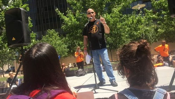 Fred Guttenberg speaks during a protest against the