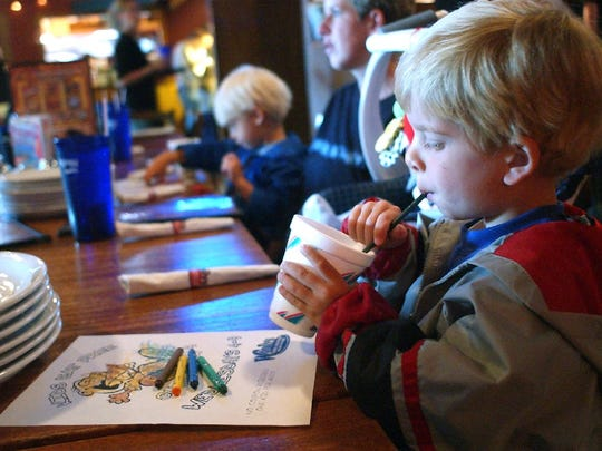 Sonder Selvig, 5, entertains himself while waiting for food at Woody's Woodfired Pizza.