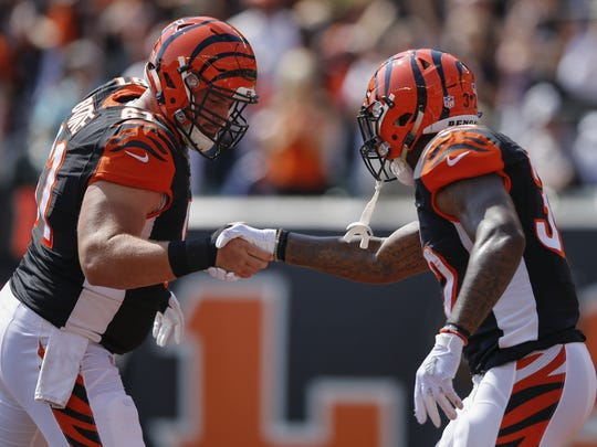 Cincinnati Bengals center Russell Bodine (61) shakes hands with Cincinnati Bengals running back Jeremy Hill (32) in celebration of Hill's touchdown run in the first quarter during the NFL game between Denver Broncos and the Cincinnati Bengals, Sunday, Sept. 25, 2016, at Paul Brown Stadium in Cincinnati.