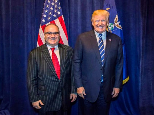 In this Oct. 25, 2017, photo acquired by The Associated Press, George Nader poses backstage with President Donald Trump at a Republican fundraiser in Dallas. Nader, a convicted pedophile, was told by the Secret Service that he could not meet the president. His business partner, Elliott Broidy, helped him secure this photo with the president.