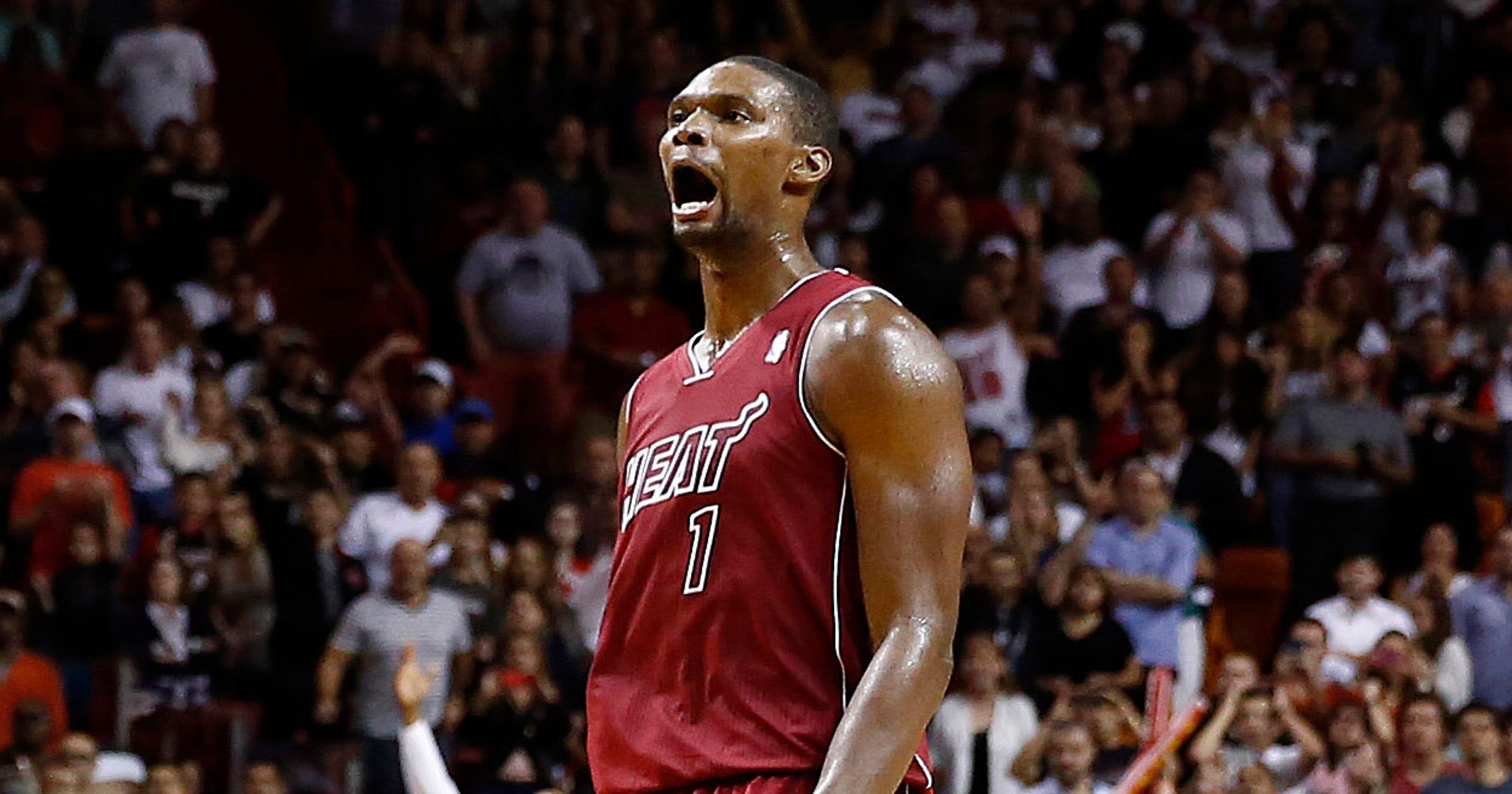 1a6d0c2eda08 Chris Bosh s late heroics lift Heat past Bobcats