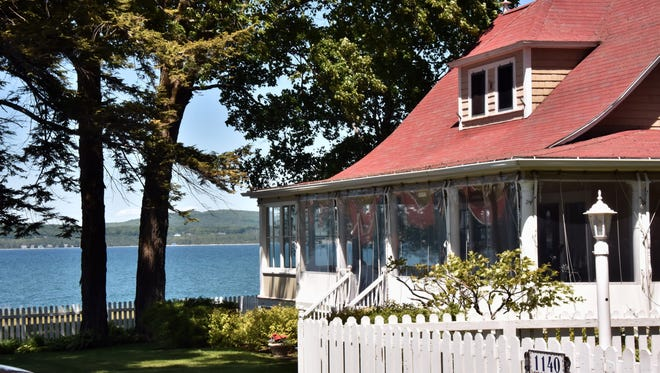 A Bay Vie cottage overlooks Little Traverse Bay Thursday, June 14, 2018  in the enclave of Bay View near Petoskey, Michigan. The 143-year-old Methodist assembly camp features 440 cottages, two hotels, a post office, beach and swim area and a sail house.