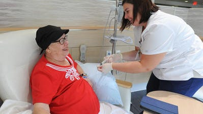 A breast cancer survivor receives treatment.