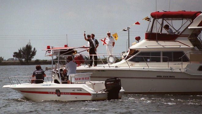 A priest blesses a boat during a past Blessing of the Fleet in Cocoa Beach.