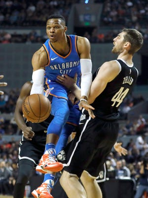 Oklahoma City Thunder guard Russell Westbrook drives against the Brooklyn Nets center Tyler Zeller in the first half at Mexico City Arena.