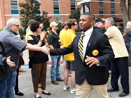 Southern Miss football players interact with fans in