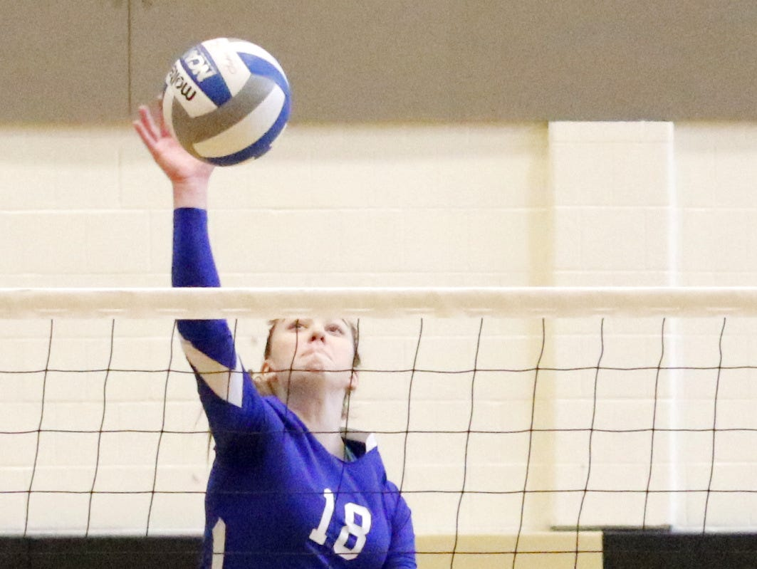 Horseheads senior Megyan Merrill goes up for a spike against Cornwall during the Blue Raiders' victory in the Class A state regionals this season at Corning-Painted Post High School. Merrill earned third-team Class A all-state honors.