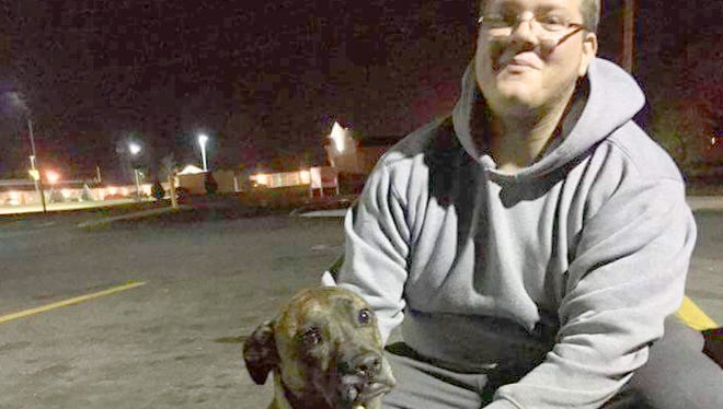 Anthony Napoli always travels with Augie, a 3-year-old Plott hound that he and a girlfriend got as a rescue animal.
