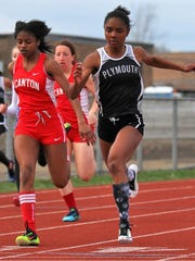 Plymouth's Ryen Draper races to the finish against a Canton runner during the Plymouth-Canton Educational Park track and field meet on April 22.