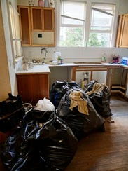 Bags of trash are removed before rehab can begin.