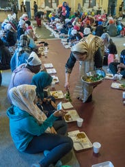 Students are served lunch by members of the Gurdwara