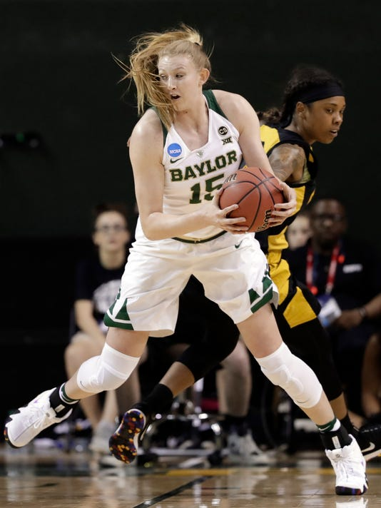FILE - In this March 16, 2018, file photo, Baylor forward Lauren Cox (15) works to the basket against Grambling State guard Takerra Parsons during the first half of a first-round game at the NCAA women's college basketball tournament in Waco, Texas. The Lady Bears are in their 10th straight Sweet 16 after Cox led them with 24 points and 16.5 rebounds per game in wins over Grambling State and Michigan to start the tournament. The power forward has four double-doubles in a row, including the semifinal and championship games of the Big 12 Tournament. (AP Photo/Tony Gutierrez, File)