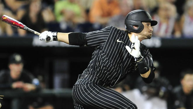 Vanderbilt's Rhett Wiseman watches his double against Cal State Fullerton during the sixth inning on Sunday night.