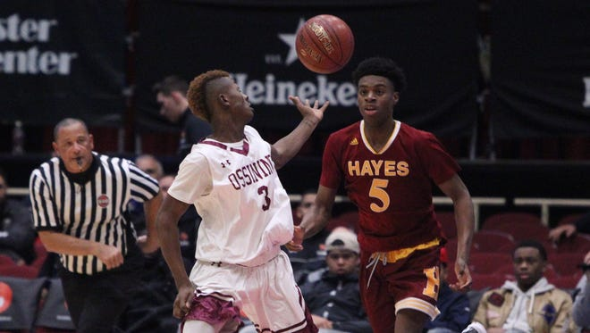 Ossining's Kahseem Trotter loses the ball to Cardinal Hayes' John Egbuta during their semifinal game of the Slam Dunk Tournament at the Westchester County Center Dec. 26, 2016.