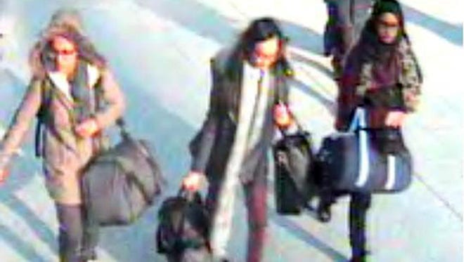 This is  a still taken from CCTV issued by the Metropolitan Police in London on Monday Feb. 22, 2015, of 15-year-old Amira Abase, left, Kadiza Sultana,16, centre, and Shamima Begum,15, going through Gatwick airport, before they caught their flight to Turkey on Tuesday Feb 17, 2015. The three teenage girls  left the country in a suspected bid to travel to Syria to join the Islamic State extremist group.