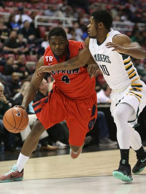 Detroit Mercy's Carlton Brundidge drives against Wright State's Biggie Minnis during the first half Sunday, March 6, 2016 at the Joe Louis Arena in Detroit, MI.