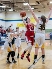 St. Philip's Abbie Lahr (23) takes her shot during first half action against Climax-Scotts Friday evening.