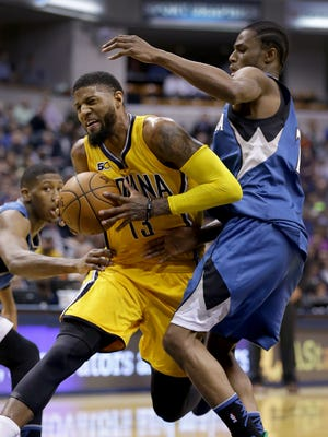 Indiana Pacers forward Paul George (13) is fouled by Minnesota Timberwolves forward Andrew Wiggins (22) in the first half of their game Tuesday, March 28, 2017, evening at Bankers Life Fieldhouse.