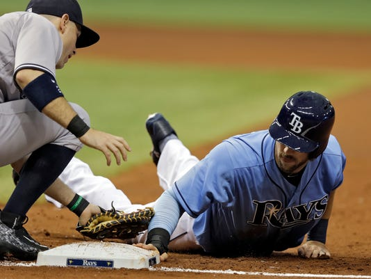 Tampa Bay Rays' Steven Souza Jr., right, dives back safely to first ahead of the tag by New York Yankees first baseman Dustin Ackley during the second inning of a baseball game Sunday, May 29, 2016, in St. Petersburg, Fla. (AP Photo/Chris O'Meara)