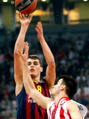 Mario Hezonja, left, of Barcelona plays during a Euroleague basketball game against Red Star in Belgrade, Serbia, on March 19, 2015.