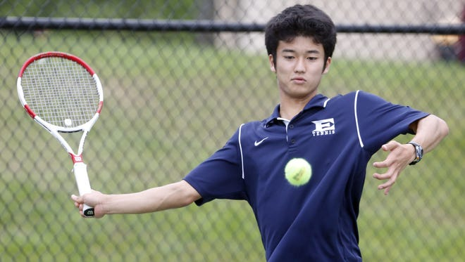 Eastchester's Taiyo Hamanaka prepares to return a shot against Dobbs Ferry's Mike Selin en route to winning the singles title 6-0, 6-4.