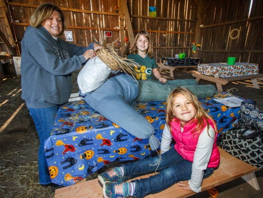 Tenley Morris (foreground), 5, and sister Rachel, 8,
