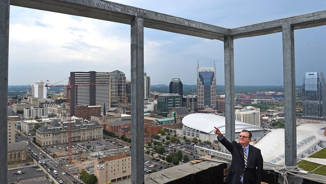 General Manager Ray Waters points out some of the amenities being built on the rooftop bar atop the Westin Nashville hotel in Nashville.