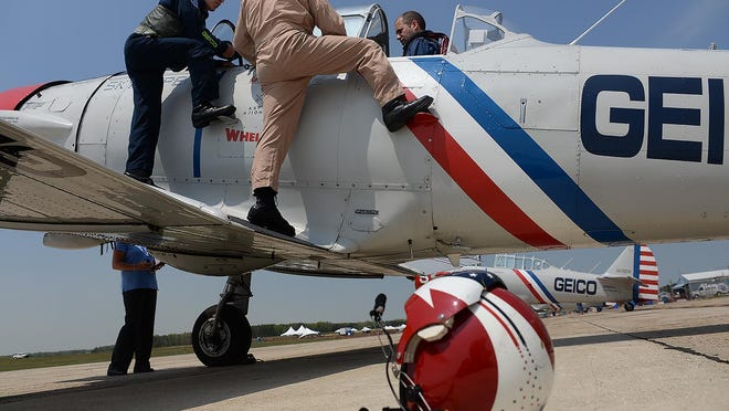 Daily Journal editor Jerry Staas Haught (right) gets seated inside a 75 year-old WWII training aircraft, SNJ-2, before flying with the Geico Skytypers, who will be performing in this weekend's Millville Airshow, Thursday, May 7, 2015 at Millville Airport. Staff Photo/Sean M. Fitzgerald