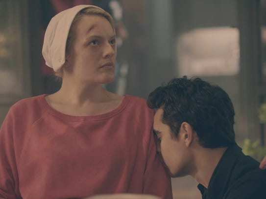 Offred (Elisabeth Moss) and Nick (Max Minghella) have