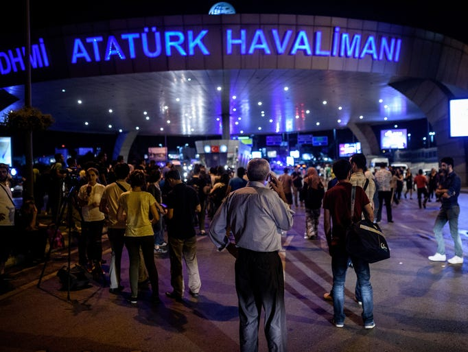 People wait outside the Ataturk airport in Istanbul,