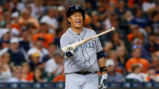 Seattle Mariners' Dae-Ho Lee reacts to a strike at bat against the Detroit Tigers in the eighth inning of a baseball game in Detroit, Monday, June 20, 2016. (AP Photo/Paul Sancya)