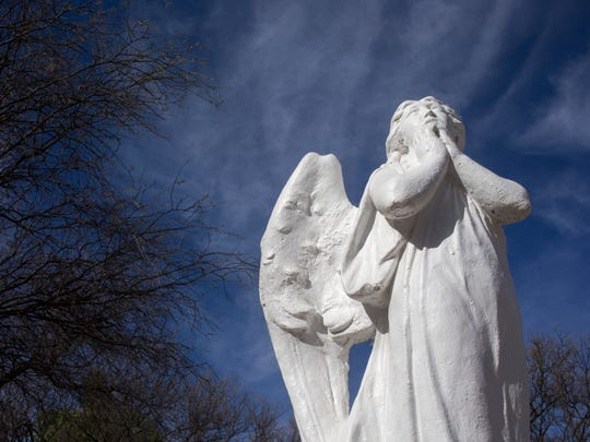 A statue in the cemetery at Holy Trinity Monastery in St. David, Arizona.