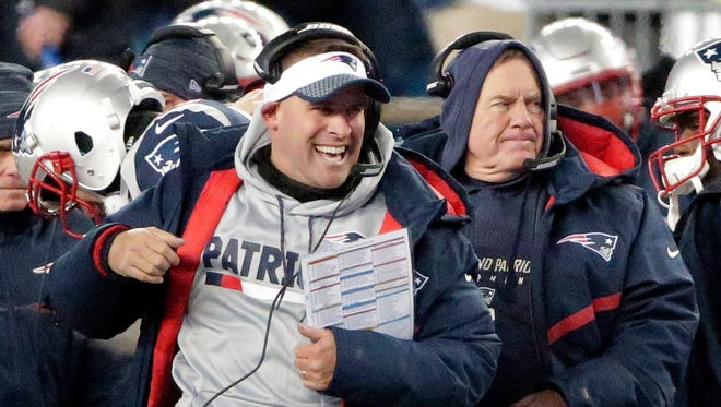 New England Patriots offensive coordinator Josh McDaniels celebrates his team's touchdown in front of head coach Bill Belichick, right, during the first half of an NFL divisional playoff football game, Saturday, Jan. 13, 2018, in Foxborough, Mass