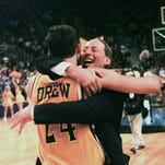 Valparaiso's head coach Homer Drew hugs his son, Bryce, after Bryce hit a game-winning 3-point shot, at the buzzer, to beat Mississippi 70-69 in the first round of the NCAA Midwest Regional Friday, March 13, 1998 in Oklahoma City.