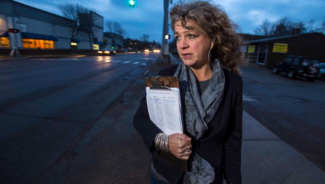 Karen Rowell opposes a proposal to reconfigure North Avenue in Burlington.  She is seen in December holding a petition with signatures of people who also oppose the proposal.